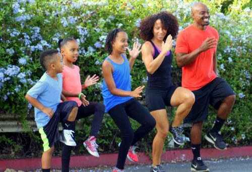 Claudine Cooper enjoys a family workout with her husband and kids outdoors.